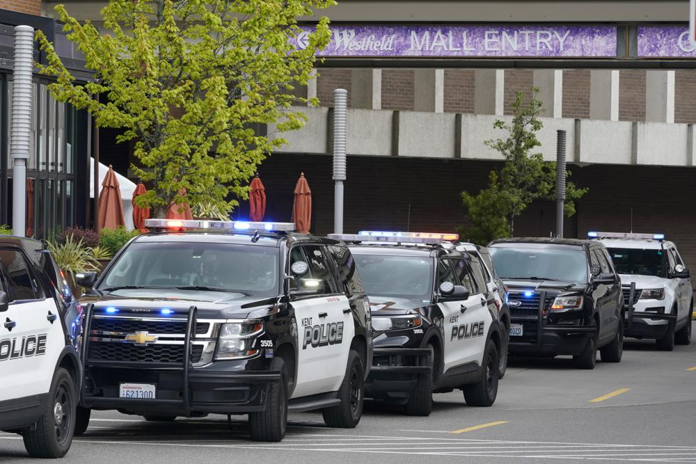Police vehicles respond to a reported shooting, Saturday, May 1, 2021, at Southcenter Mall in Tukwila, Wash., south of Seattle. (AP Photo/Ted S. Warren)