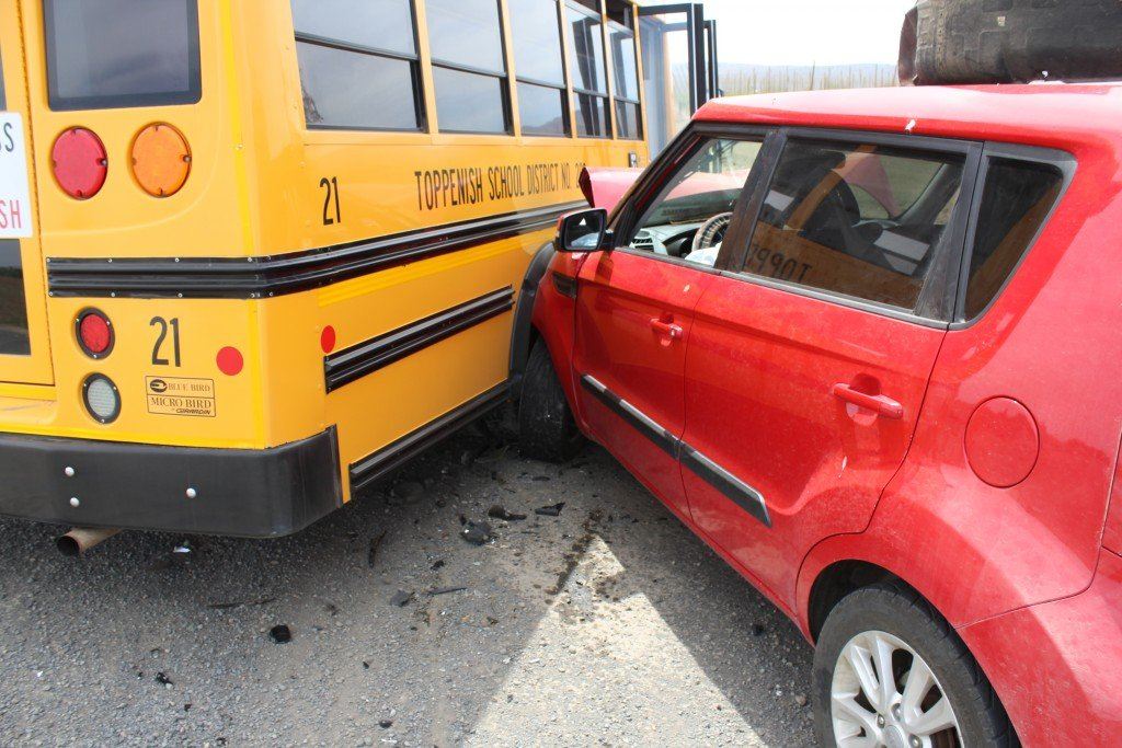 Toppenish schoolbus struck in sudden collision; senior and juvenile sent to hospital