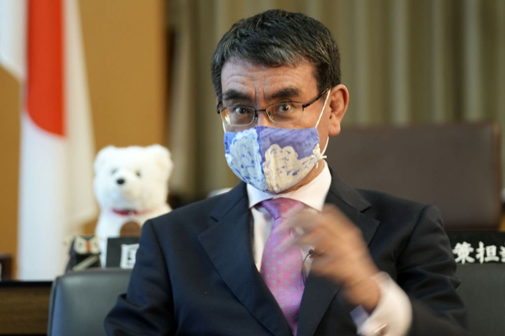 Ap Interview: Japan Minister Urges Young To Get Vaccinated