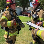 Kennewick fire spreads to house from weeds burning outside