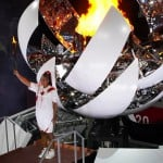 Naomi Osaka Lights Tokyo Games Cauldron With Olympic Flame. See Scenes From The Opening Ceremony.