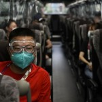 Ap Photos: Olympic Guests Get View Of Tokyo — From The Bus