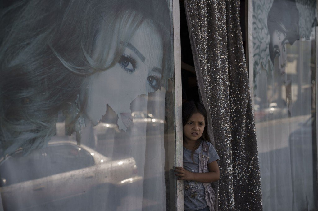 The Latest: Taliban To Female Kabul City Workers: Stay Home