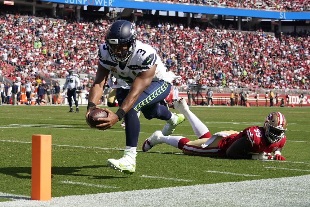Russell Wilson becomes fastest quarterback to 100 wins in NFL history